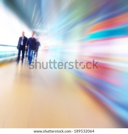 People in motion blur walking in the office corridor. - stock photo