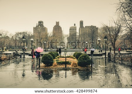 People in New York City, New York, America in the rainy day of winter.  New York City is centered of finance and fashion of the world. New York City is the most populous city in the United States. - stock photo