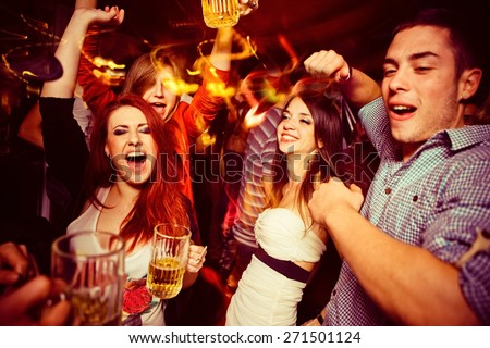 People in night club. Dancing, drinking and having fun - stock photo