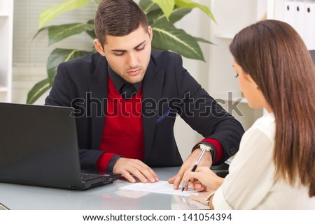 People in office signing contract - stock photo
