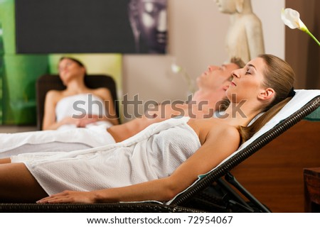 People in relaxation room after doing sports or sauna - stock photo
