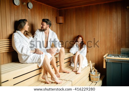 People in sauna relaxing and staying healthy - stock photo
