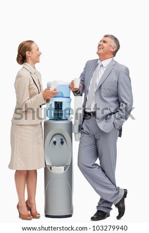 People in suit laughing next to the water dispenser against white background