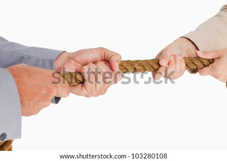 People in suit pulling the rope against white background