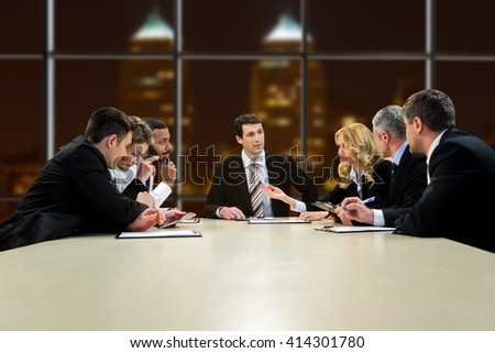 People in suits having discussion. Working collective at late hours. They have too much work. Problem has to be solved. - stock photo