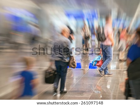 People in the airport. Motion blur. - stock photo