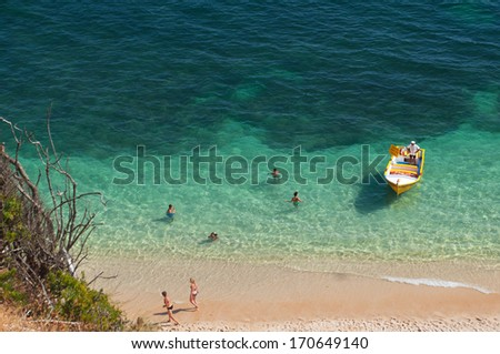 People in the beach. Summer in Algarve, Portugal - stock photo