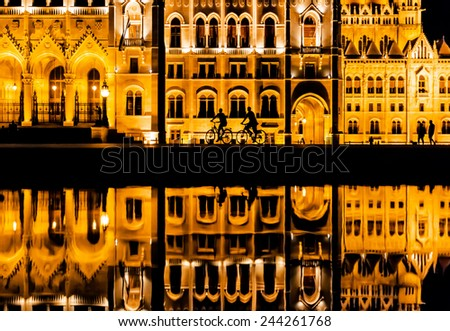 people in the city by night - stock photo