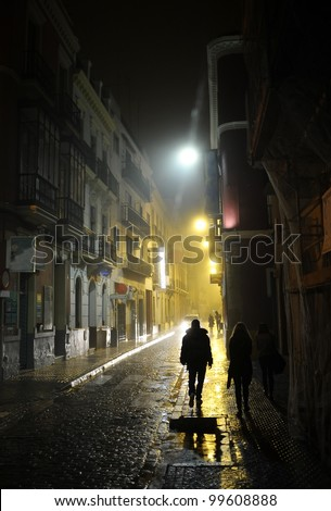 People in the dark alley - stock photo