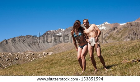 People in the mountains and sunbathe fooling around...