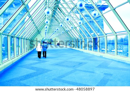 people indoor glass corridor - stock photo