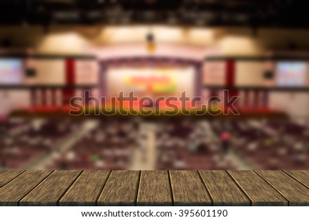 people is waiting for presentation in conference hall (blur background with wood table top for display or montage your product) - stock photo