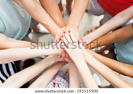 People joining hands - stock photo