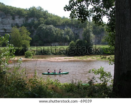 People kayaking on a river - stock photo