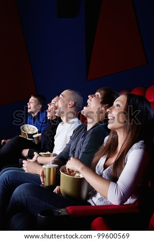 People laugh at the cinema