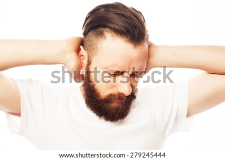 people, life style  and emotional  concept - bearded man covering his ears by hands over white  background - stock photo