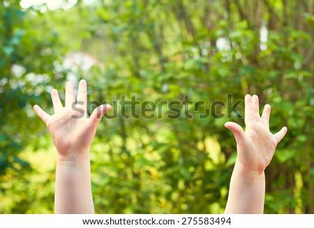 people - little girls hands outdoor - stock photo