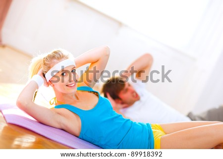People making abdominal crunch in gym - stock photo