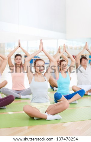 People meditate in a classroom