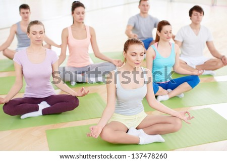 People meditating in lotus position - stock photo