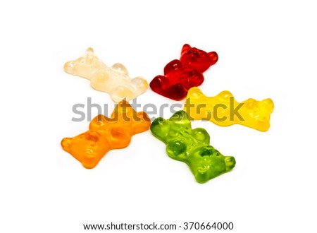 People Meeting Corporate Planning Brainstorming Concept - Jelly bears being arranged in a circle with shadows on white background - stock photo