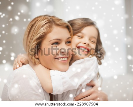 people, motherhood, family, winter and adoption concept - happy mother and daughter hugging at home - stock photo