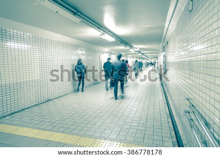 People moving fast through a subway station - stock photo