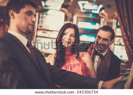 People near slot machine in a casino - stock photo