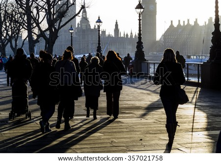 People of London walking in the sunset at Thames path with Big Ben at background, London, UK - stock photo