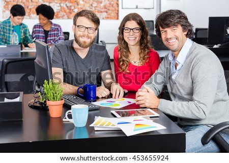 People office diverse mix race group businesspeople designers working sitting desk smile looking camera casual wear - stock photo