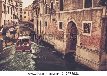 People on a boat riding in Venice