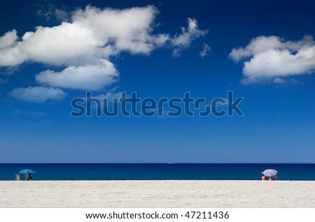 people on a tropical beach - stock photo