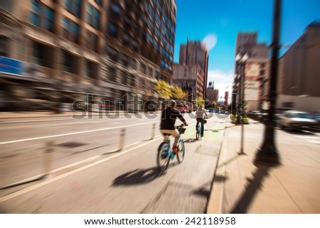 People on bikes in Chicago streets - stock photo
