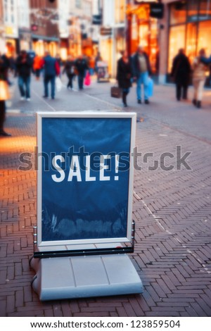 people on dutch street during winter sale - stock photo