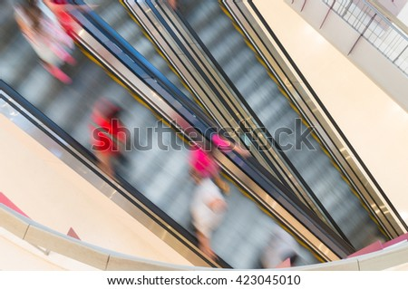 People on Escalator, Motion Blur Top view - stock photo