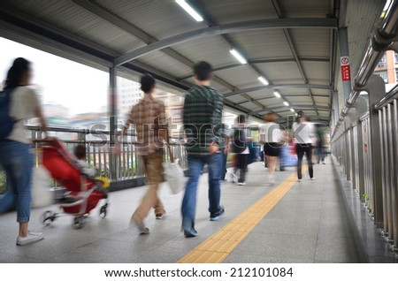 people on pedestrain bridge - stock photo