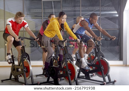 People on the cycles in the gym.