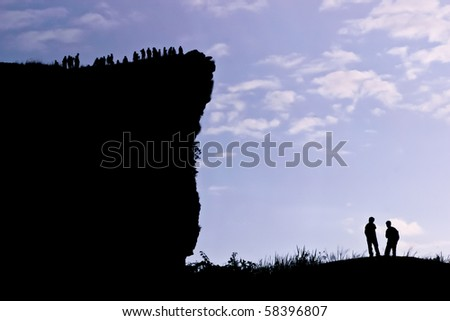 People on the peak of mountain in the morning at the northern of Thailand - stock photo