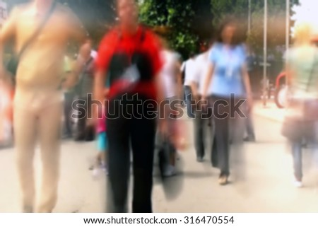 People on the Street Walking in a Hurry ,commute Unrecognizable Crowd out of focus - stock photo