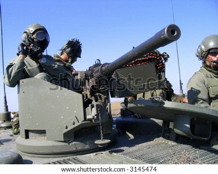 People on the tank. Army - stock photo