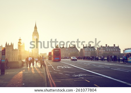 people on Westminster Bridge at sunset, London, UK - stock photo