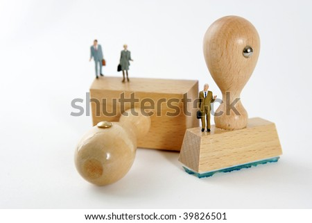 People on wooden rubber stamps on white background - stock photo