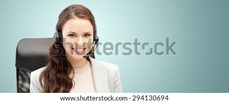 people, online service, communication and technology concept - smiling female helpline operator with headset over blue background - stock photo