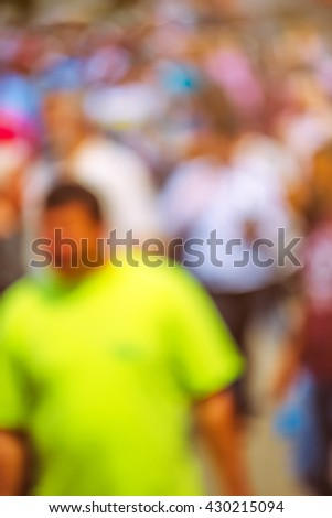 People out of focus on the street, unrecognizable everyday crowd in public place - stock photo
