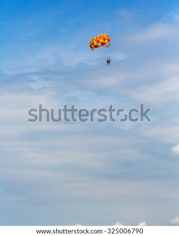 People parasailing over the sea - stock photo
