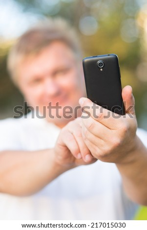 people photographed on a smartphone