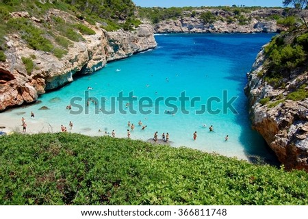 People playing on the beach Calo des Moro - stock photo