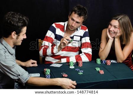 people playing poker - stock photo
