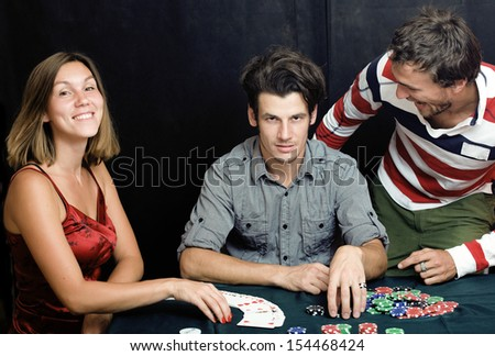 people playing poker at home - stock photo