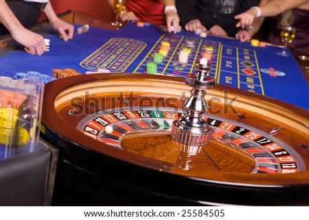 People playing roulette - stock photo